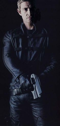 BAMF! Martin Freeman<---OMFG I think I just busted an ovary.(What is this from? OMG I must know! tell me!!) Martin is tightly wrapped in black leather,gripping a futuristic gun, bein' all tough & serious, & sexy, & I don't know what this is yet! Auughhh!!!!
