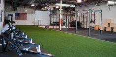 I like how the rowing machines are lined up on the side there on the other side of the turf. | Build Your Box