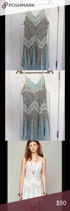 "Free People In and Out Ditsy Floral Slip Dress I only wore this twice then had it dry cleaned. In like new condition. Feel free to ask questions. I'm 5'5"" and this is long enough to wear as a dress. Please keep in mind when submitting offers that poshmark takes 20%. This is also listed for less on my eBay account: photoflo10. Free People Dresses Mini"