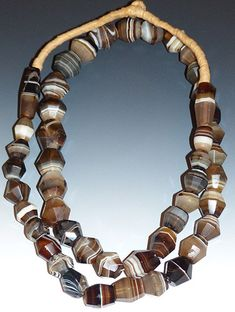 Amazing strand of old agate beads from Africa. The beads are hand cut, probably in Germany in the Century, and then apparently traded to Africa. The artist clearly took his or time in cutting the African Beads Necklace, African Jewelry, Beaded Jewelry, Jewelry Necklaces, Beaded Necklace, Bracelets, Agate Beads, Glass Beads, Walmart Jewelry