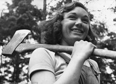 Wood cutter: Cicely Clark of The Women's Timber Corps at work in a timber camp in Suffolk as part of the war effort in 1942