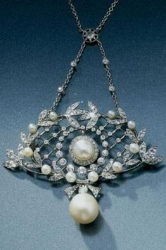 A BELLE EPOQUE PEARL, CULTURED PEARL AND DIAMOND PENDANT/BROOCH, CIRCA 1905. In the Garland Style, the trellis of foliate motifs millegrain-set with circular-, single- and rose-cut diamonds and seed pearls, with a pearl and diamond swing centre and supporting a later brilliant-cut diamond and cultured pearl drop, on a detachable chain necklet spectacle-set with circular-cut diamonds, French assay marks, fitted case by G. Fouquet with screw driver and brooch fitting. #BelleÉpoque #pendant…