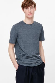 A classic round-neck style, this t-shirt is made from cotton with a melange texture. A regular fit, it has short sleeves and neatly finished edges.