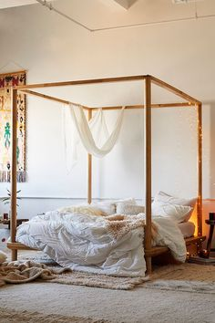 Eva Wooden Canopy Bed from urban outfitters, boho bed, bohemian home decor, bohemian bedroom