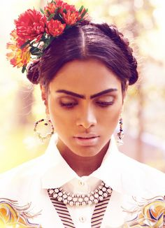 I always appreciate a good Frida style. Especially the flowers in the hair.