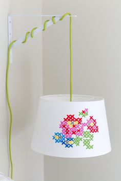 "DIY Painted Cross Stitch Lamp Shade - if you can't cross stitch, just use paint to get the ""cross stitch look"" (although it *is* pretty easy to learn!)"