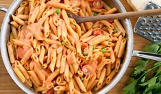 Penne alla Vodka sounds fancy but this restaurant style pasta takes only minutes to prepare at home. The vodka adds a nice zing to the rich creamy tomato sauce. Perfect for a weeknight dinner. Vodka Recipes, Pasta Recipes, Cooking Recipes, Yummy Recipes, Yummy Food, Healthy Cooking, Healthy Eating, Penne Alla Vodka, Creamy Tomato Sauce