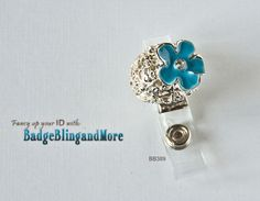 Silver swirly mound with a pretty blue flower on top  -  Badge Clip BB389. $10.00, via Etsy.