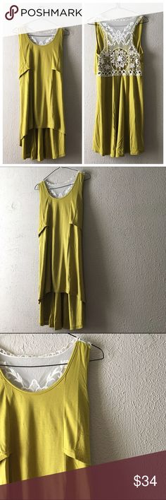 """Lace Back Tunic Tank Perfect for spring beautiful chartreuse tank top with delicate and elegant Lace back. High hem in front, longer hem in back. Has a relaxed flow fit. Length: front/back Medium: 28""""/36"""" Medium: 18""""//PRICE FIRM UNLESS BUNDLED Infinity Raine Tops"""