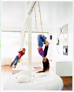 A simple swing and giant floor cushions. [The cushions are stuffed with the guts of old foam pillows and encased in faux fur]