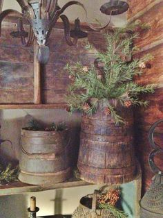 Filling my new wooden tall bucket with fir tree cuttings!
