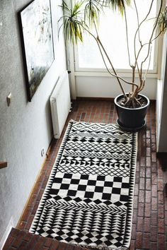 A black and white rug can make any crappy tiled floor  look fabulous. Must get for my new terrace! It has ugly floors