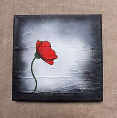 Small Original Painting, created using Acrylic.  Applied using a sponge, and paintbrush. The Bold black outline of the Poppy makes it really pop. Rather like the cool school, pop art paintings.. The background itself is Black, fading into grey & wh...