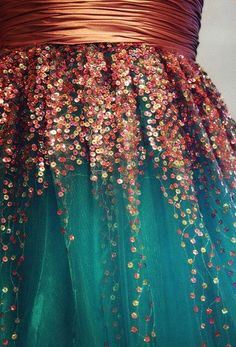 Charity teal and copper sequined dress.