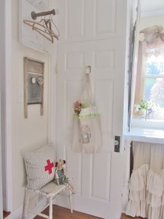 Junk Chic Cottage: Laundry Room/I like the cross & ticking pillow! Idea for the future.