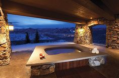 Hot Tub. Candles. Stone. Snow. Wouldn't this be perfect up on the mountain.