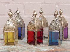 These would be great with LED tea lights in them, especially with the hooks on the top to suspend them from a handle and carry them to light your way. These are modern productions of a model common for centuries. - Red Glass Lantern