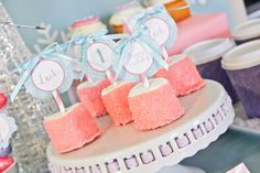 Pastel marshmallow pops at a Winter Wonderland Party #winter #marshmallow