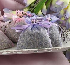 A great idea for bridal showers and weddings, our delightfully-scented Lavender Sachets are simple, elegant, and destined for appreciation!  Each favor is made from a dainty organza bag packed with fragrant French lavender.  The sachet favor is tied with a matching satin ribbon, and completed with a beautiful rose accent.  Two variations: traditional lavender ribbon and rose, or pink ribbon and rose accents.  The finished sachet measures approximately 3 inches by 4 inches.  Min. accepted…