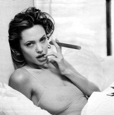 Shouldn't smoke in bed...Angelina Jolie and cigars