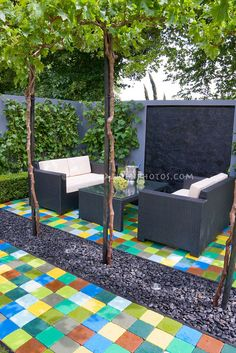 Colored pavers are almost lie a rug! This is actually really fun idea!