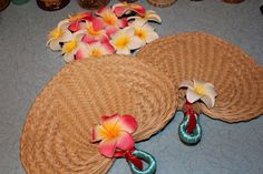 Cute tiki fans - fans from Oriental Trading, clip on flowers from Hilo Hattie's.    Tikilife: DIY: Wedding Fans
