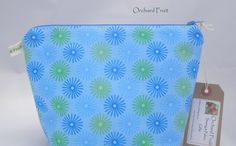 Blue and green stars - larger zipped make-up/wash bag by OrchardFruit on Etsy