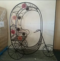 This beautiful, iron bike would make a great addition to your garden this spring! Simply add a few flower pots or décor items and voila!  #wroughtiron #plantstand #gardendecor #outdoor #floral #bicycle #decorative