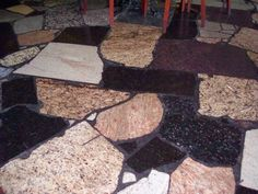 Fun floor made out of leftover granite pieces. Bar top?
