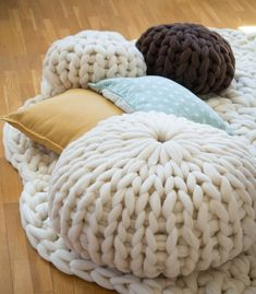 Round cushion: Hand-knitted cushion made of 100% Merino wool. Filled with remains of natural yarn. Size: 19.68 inches diameter and 11.81 inches height