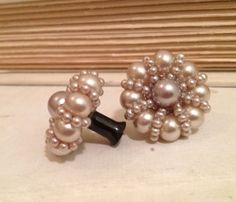 While I am not a fan of huge plug earrings -- these are really pretty. Antique pearl Plug Earring 6 gauge 4mm. $27.00, via Etsy.