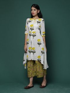 Size Chart (In inches)- These are garment measurements. Length of kurta fronts is 45 inches & back 55 inches, Length of pants is 42 inches. XS - Chest : 32,