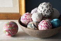 fabric scrap balls - scraps wrapped around old tennis/ base balls and yarn balls