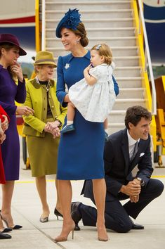 Kate Middleton Photos Photos - The Prime Minister of Canada Justin Trudeau, kneels to talk to Prince George and  the Duke of Cambridge (out of frame) as Catherine, Duchess of Cambridge and Princess Charlotte of Cambridge arrive at Victoria International Airport on September 24, 2016 in Victoria, Canada. - 2016 Royal Tour to Canada of the Duke and Duchess of Cambridge - Victoria, British Columbia