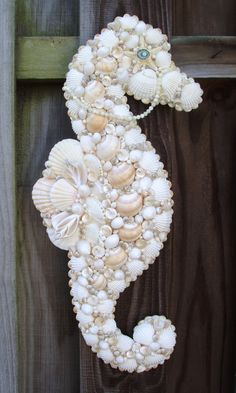 ❥ seashell seahorse ornament but I'm thinking door decor at the beach house