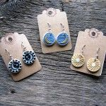 Sun, Moon and Star earrings designed by fine artist Cara O'Brien member at Gallery Uptown located in Grand Haven, Michigan.