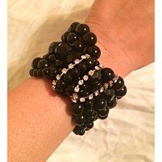Black Stretchy Statement Bracelet Great Condition! Multi stretchy bracelets attached by the center Silver New York & Company Jewelry Bracelets