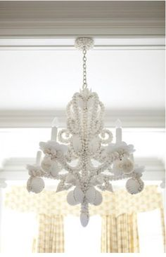 A coral chandelier against a blue wall - simply fabulous ...