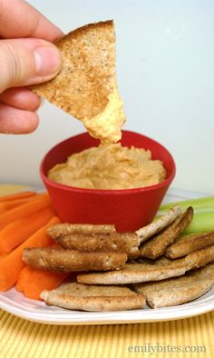 Buffalo Wing Hummus Ingredients: 1 ½ cups canned chickpeas, drained and rinsed (reserve ¼ cup of the liquid from the can) 2 cloves garlic 2 T tahini 2 T fresh lemon juice ¾ t paprika 1 T barbecue sauce 1 ½ T Frank's Red Hot (or similar cayenne pepper sauce) 1 ½ teaspoons white vinegar ¾ t salt