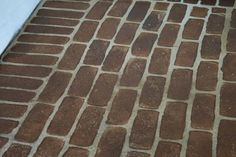 """DIY: Faux Stained Brick Floor Tutorial - concrete floor that was """"faux bricked"""" using an auto sponge from Walmart & stain. use a cellulose sponge and paint then stain if aging is desired. Can be done on walls also Stained Brick, Stained Concrete, Brick Flooring, Concrete Floors, Concrete Porch, Concrete Bricks, Concrete Slab, Brick Walls, Outdoor Projects"""