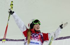 Canada's Justine Dufour-Lapointe celebrates her Gold Medal during the Women's Freestyle Skiing Moguls finals at the Rosa Khutor Extreme Park during the Sochi Winter Olympics on February 8, 2014. AFP PHOTO / JAVIER SORIANO (Photo credit should read JAVIER SORIANO/AFP/Getty Images)