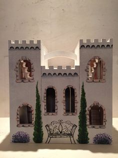 Welcome to my fairytale! What little girl doesnt want to get lost in an enchanting castle? Each castle is a hand painted, one of a kind piece. Perfect size for Disney MagiClip dolls. The inside of the castle is wallpapered and hand painted pieces adorn the walls, such as dresses, furniture, chandeliers, etc. This castle is white with pink accents. It is glittered and sparkling on the outside. This is a wonderful gift for the little girl who loves princesses and fairytales, or as a beautiful…