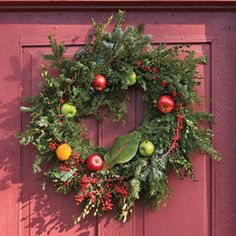 Winter Fruit Accent  ~~Accentuate a basic wreath with fresh fruit—red and green apples and oranges—for a classic look.