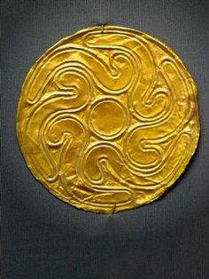 Gold roundels with repousse motifs: butterfly, octapus, leaf, rosette, spirals and whorls Th tiny holes along the edge indicate that most of these roundels were sewn onto fabric Mycenaean art Grave III Grave of the woman Grave Circle A Mycenae 16th century BC. National Archaeological Museum Athens Greece