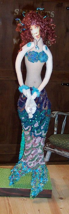 The Mermaid.  Cloth sculpted body with rug hooked tail and needle-felted and beaded top and needle-felted hair.