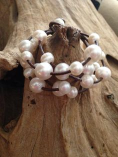 Leather and Pearls!  Pearls and Leather Bracelet!  I love the variation in the size pearls on this pretty piece!  The large (12-13mm) pearls contrast beautifully with the smaller (9-10mm) pearls!  This is a great addition to your collection.MADE TO ORDER IN YOUR DESIRED LENGTH.About Our Jewelry:Drawing inspiration from the southern charm and laid back lifestyle of Scenic Highway 30-A in Santa Rosa Beach, Florida, Christian Oliver Pearls is a true reflection of the coastal lifestyle along…