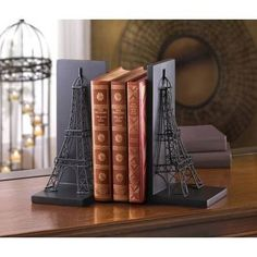 EIFFEL TOWER BOOKENDS by Smart Living Company  Retail Price: $39.95  PRODUCT DESCRIPTION: Your books will instantly be more continental and well traveled when you stand them between these Eiffel Tower Bookends! One of the worlds most recognizable landmarks can be yours (two, in fact!) created from black metal wire and set on a metal base that's backed with flat anchors to keep them in place.  http://www.smartlivingcompany.com/eiffel-tower-bookends