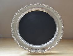 Upcycled vintage silverplate tray chalkboard! Get a fancy cheap plate from Goodwill then spray the center with chalkboard paint!