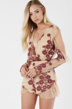 6a81cddc667d Gorgeous mesh romper with cold shoulder cut out and deep V-neckline. Bold  floral embroidery throughout with flirty ruffle trim detailing.