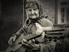 An old women and her trusty guitar